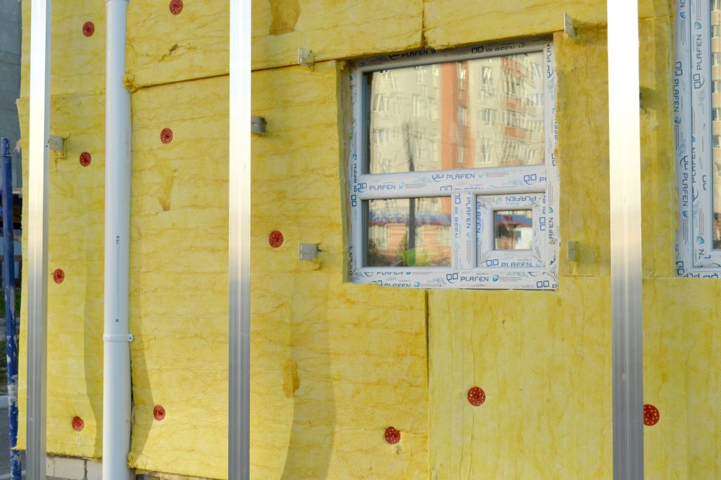 Normal insulation is good for room acoustic treatment too, just wear gloves and a respirator when working with the material, Outside.