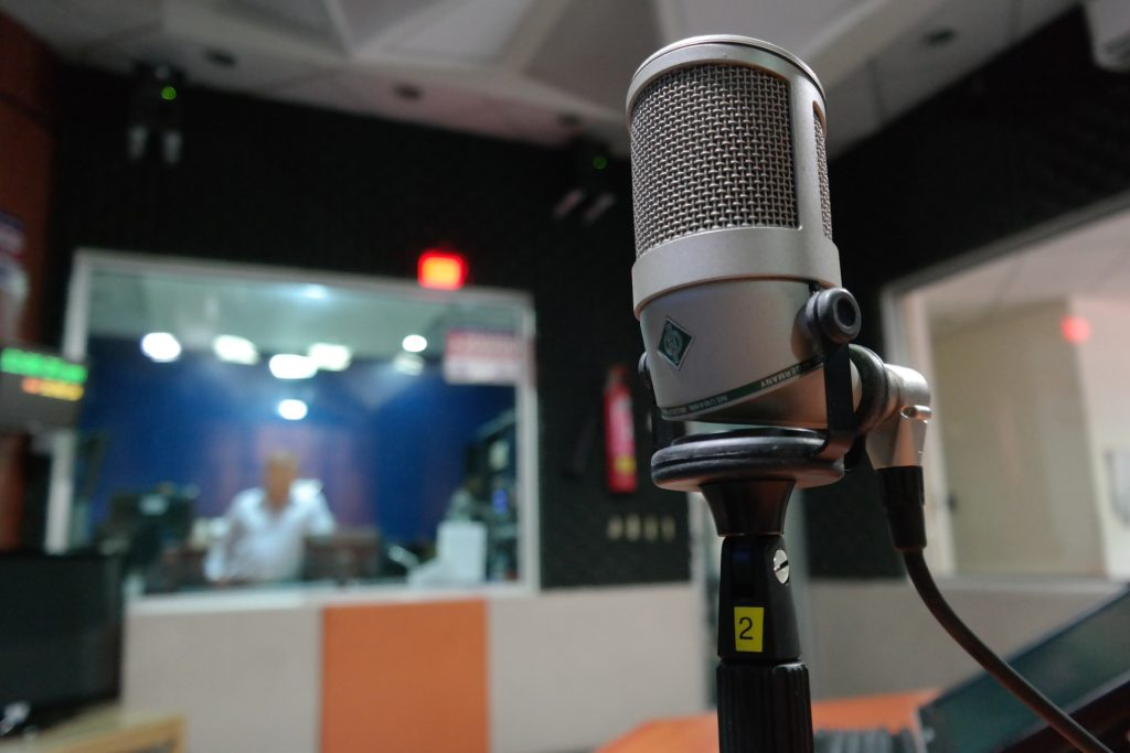 A microphone located at the center of a room that has been acoustically treated.