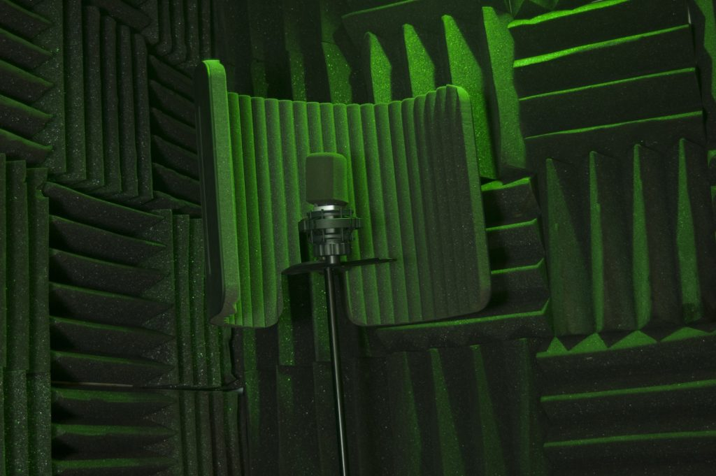 A microphone situated in an acoustic foam treated room