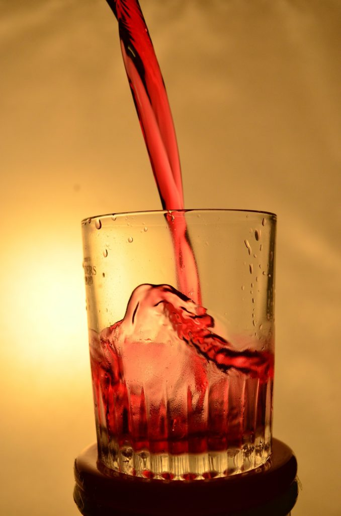 Electrolyte infused drink being poured into a glass.