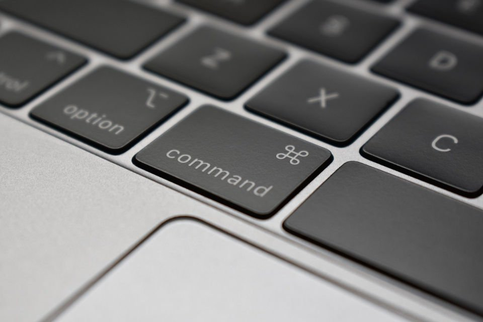"Decorative image featuring the mac ""command"" button"" Symbolizing the purpose of ""Twitch Commands""."